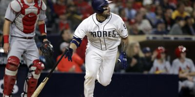 San Diego Padres' Raffy Lopez, center, watches his home run in front of St. Louis Cardinals catcher Carson Kelly during the seventh inning of a baseball game Thursday, May 10, 2018, in San Diego. (AP Photo/Gregory Bull)